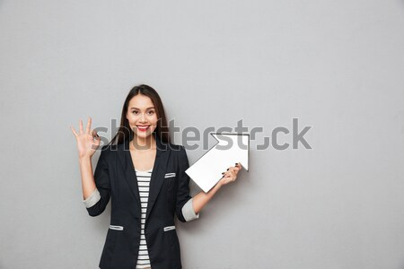 Inspired attractive young woman with long hair standing and dreaming Stock photo © deandrobot