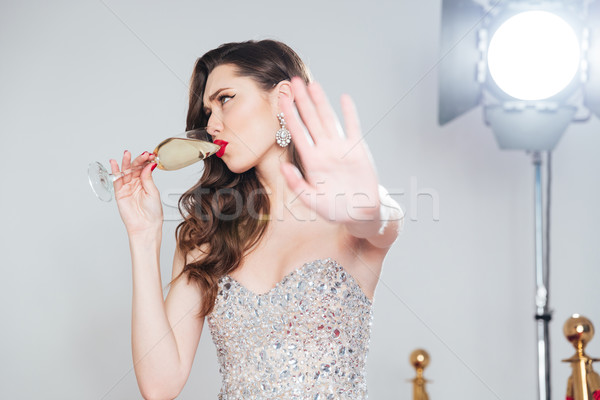 Charming woman drinking champagne Stock photo © deandrobot