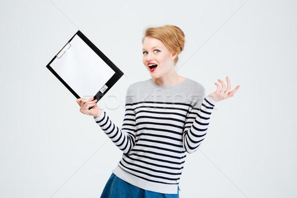 Maravilhado mulher jovem clipboard isolado branco Foto stock © deandrobot