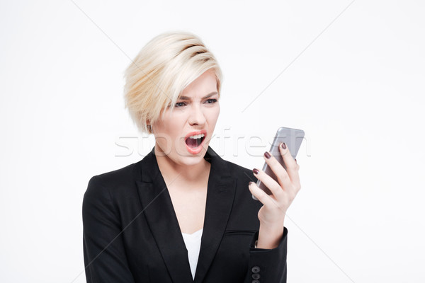 Disappointed businesswoman using smartphone Stock photo © deandrobot