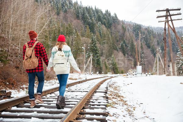 Couple walking on railway Stock photo © deandrobot