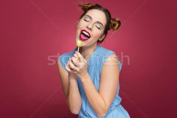 улыбаясь довольно леденец пения Сток-фото © deandrobot