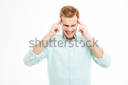 Stressful depressed man touching temples and having headache Stock photo © deandrobot
