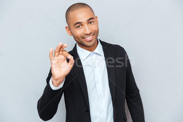 Fiatal fickó mutat oké felirat szürke Stock fotó © deandrobot