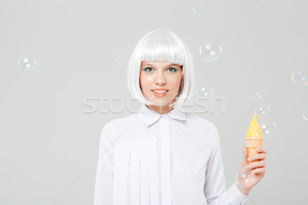 Gülen genç kadın peruk sahte Stok fotoğraf © deandrobot