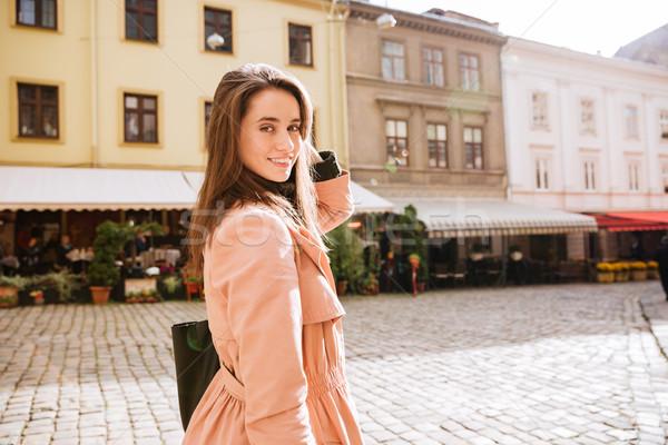 笑みを浮かべて ファッション モデル コート 手 顔 ストックフォト © deandrobot