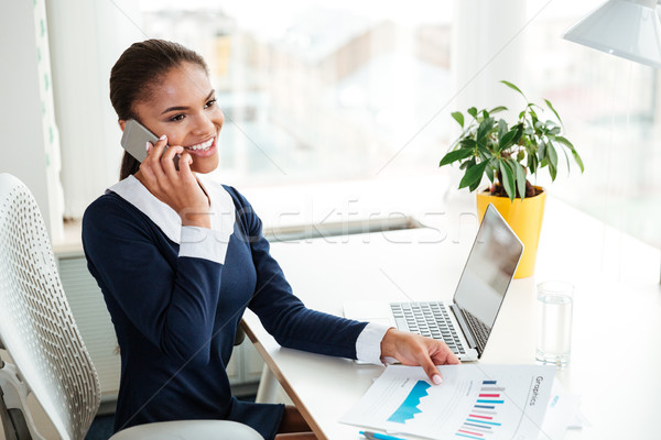 Stock photo: African business woman talking on phone
