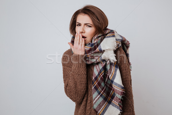 Tired woman in sweater and scarf Stock photo © deandrobot