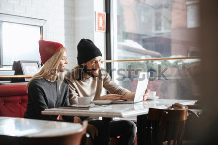 Side view of Couple making selfie in cafe Stock photo © deandrobot