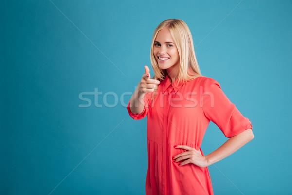 小さな 幸せ 女性 赤いドレス ポインティング 指 ストックフォト © deandrobot