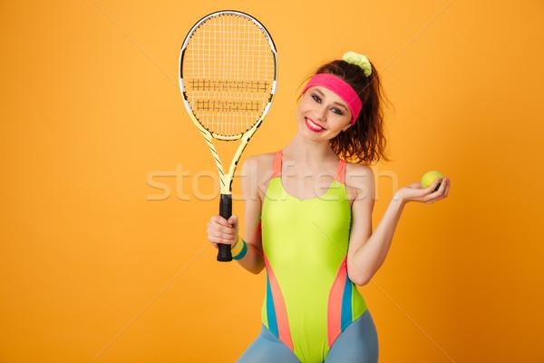 Boldog gyönyörű fiatal fitnessz nő teniszütő labda Stock fotó © deandrobot