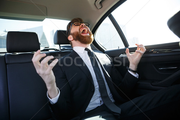Happy business man received good news Stock photo © deandrobot
