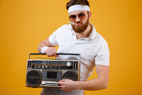 Knappe man zonnebril tape Stockfoto © deandrobot