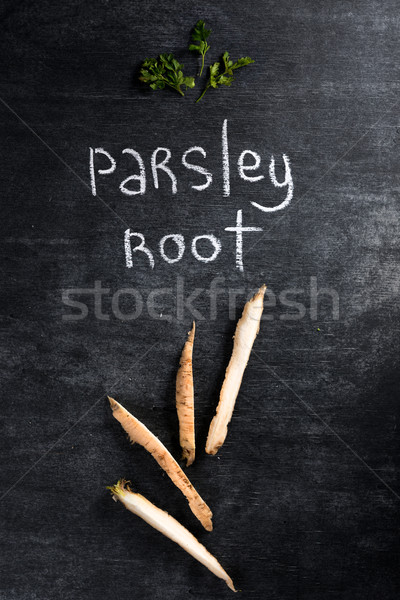 Parsley root over dark chalkboard background. Stock photo © deandrobot
