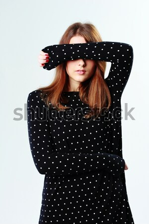 Young funny woman in hat covered in blanket standing Stock photo © deandrobot