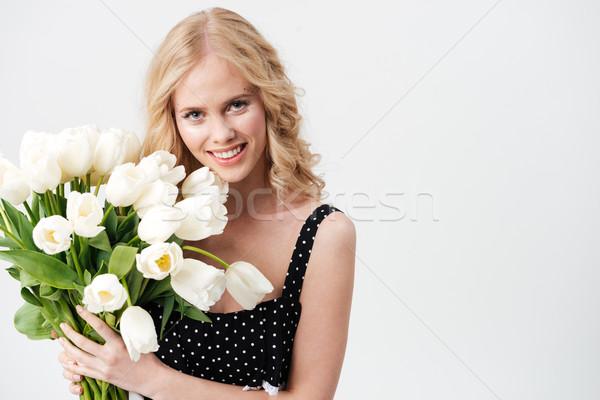 Csinos szőke nő pózol virágcsokor virágok ruha Stock fotó © deandrobot