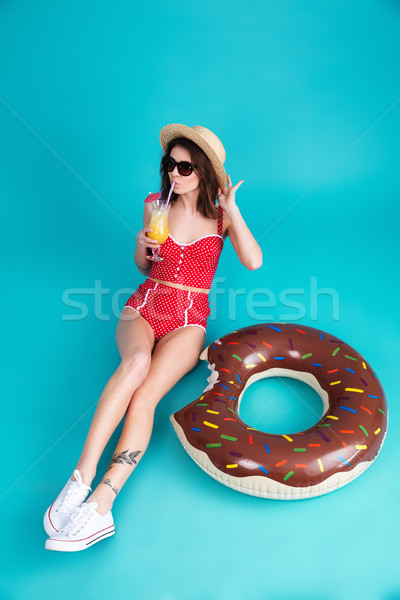 Pretty young lady dressed in swimwear wearing sunglasses Stock photo © deandrobot