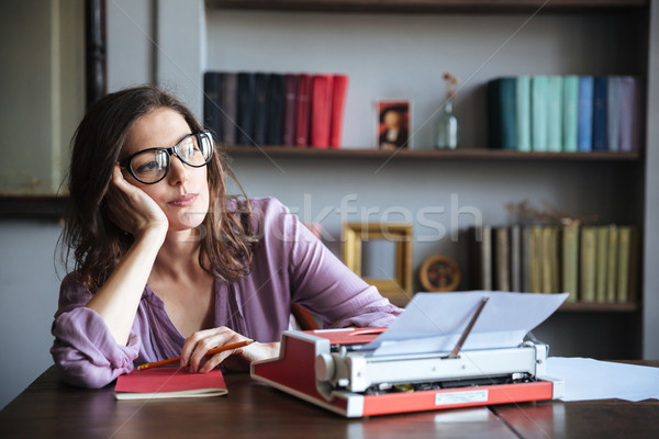 Pensive mature authoress in eyeglasses thinking and looking away Stock photo © deandrobot