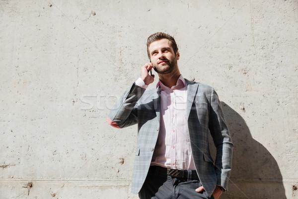 Homme veste parler téléphone portable portrait Photo stock © deandrobot