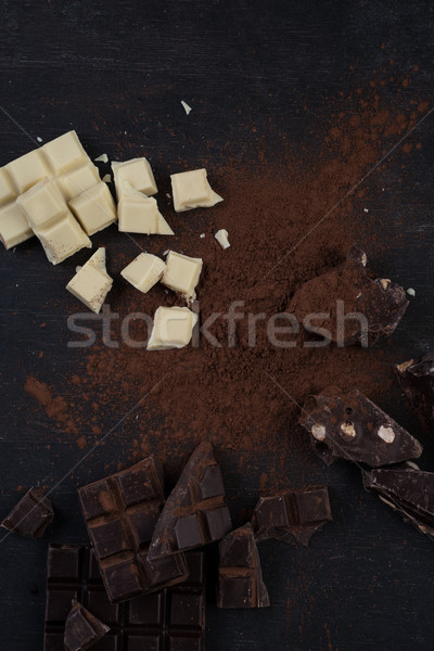 Assortment of different types of chocolate bars crashed into pieces Stock photo © deandrobot