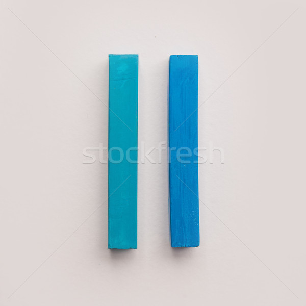 Two pieces of blue pastel crayon chalks Stock photo © deandrobot