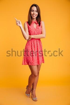 Portrait jeunes heureux femme robe rouge Photo stock © deandrobot