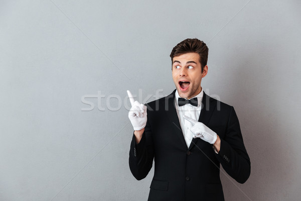 молодые официант указывая фото Постоянный Сток-фото © deandrobot