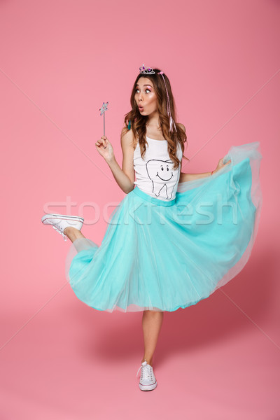 Full-length photo of amazed pretty girl in crown holding magic w Stock photo © deandrobot