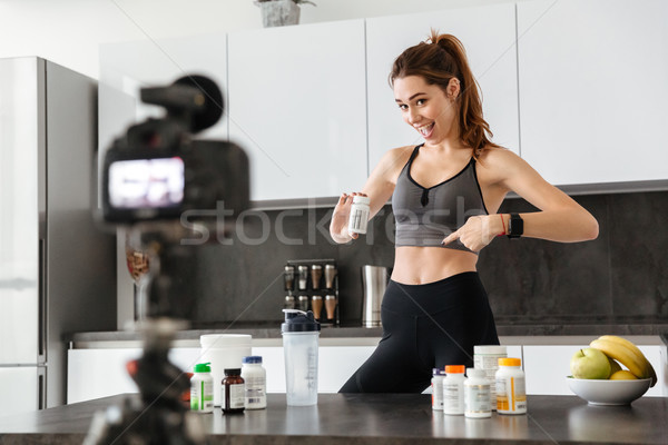 Happy healthy young girl recording her video blog Stock photo © deandrobot