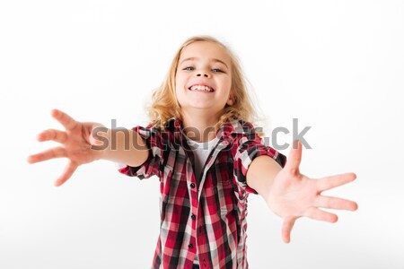Portrait of a friendly little girl with outstretched hands Stock photo © deandrobot