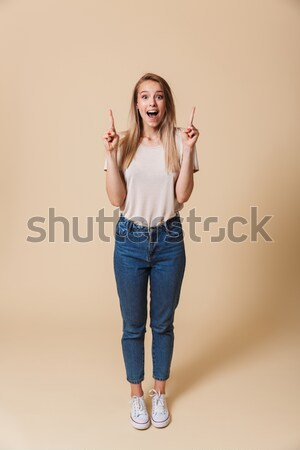 Half-turn photo of charming woman with long brown hair holding s Stock photo © deandrobot