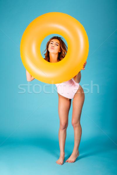 Full length portrait of a pretty girl dressed in swimsuit Stock photo © deandrobot