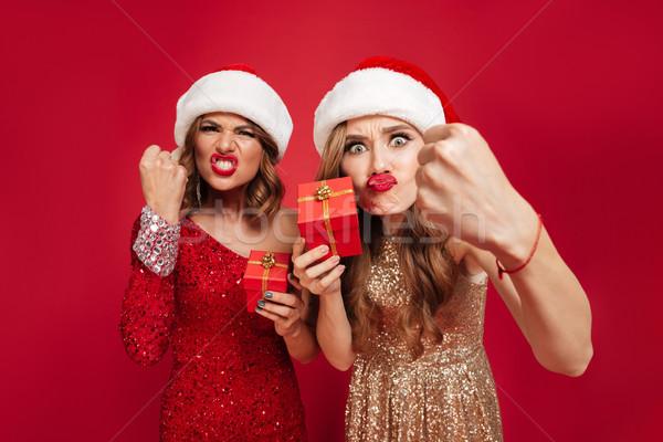 Portré mérges dühös nők karácsony sapkák Stock fotó © deandrobot