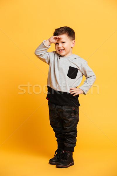 Uśmiechnięty mały chłopca dziecko stałego odizolowany Zdjęcia stock © deandrobot