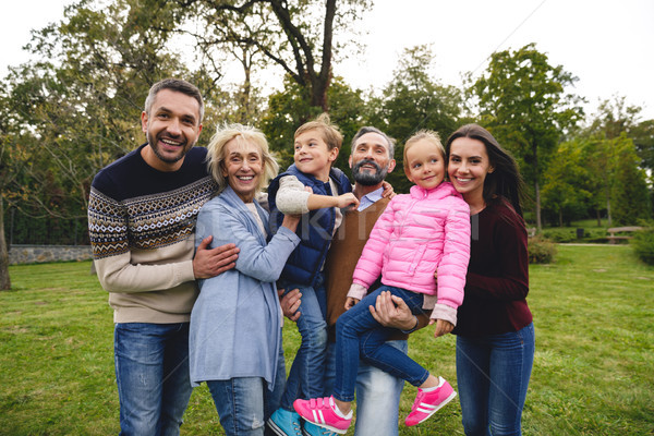 Cheerful big family spending time Stock photo © deandrobot