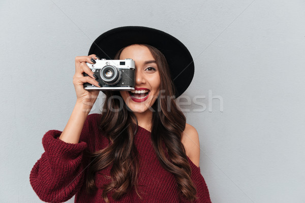 Close-up portrait of young hipster brunette woman looking throug Stock photo © deandrobot