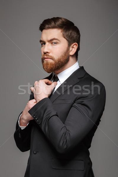 Portrait of a serious young businessman Stock photo © deandrobot