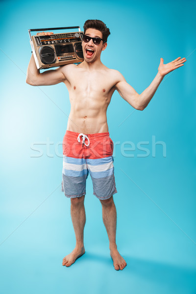 Full length portrait if a cheerful shirtless man Stock photo © deandrobot