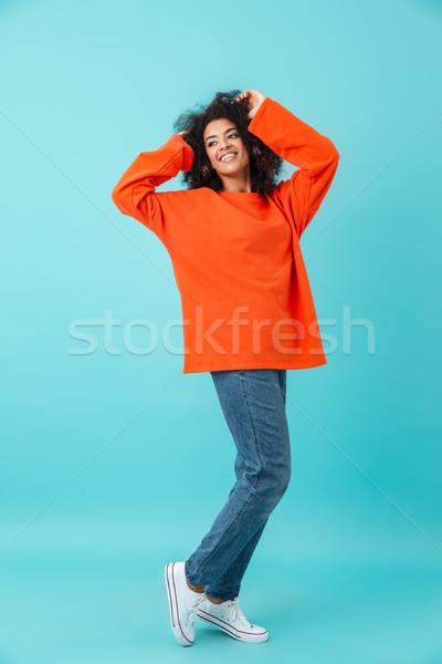 Foto americano donna arancione shirt Foto d'archivio © deandrobot