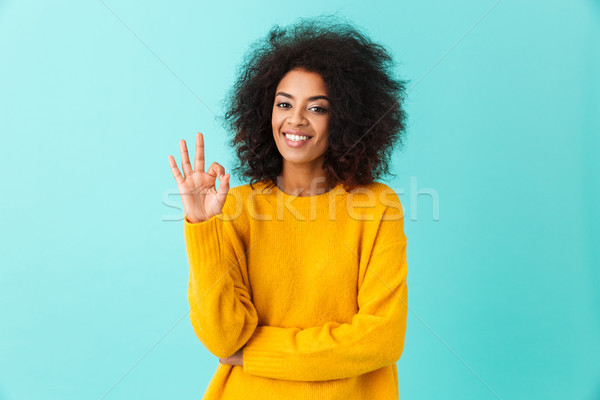 Content american woman in colorful shirt smiling on camera and g Stock photo © deandrobot