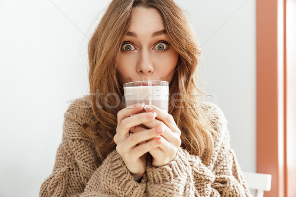 Photo of joyous young woman 20s looking on camera with exciting  Stock photo © deandrobot