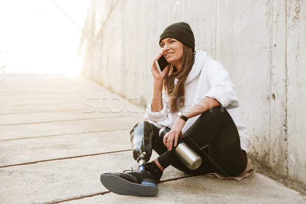 Photo of happy handicapped woman in casual wear having bionic le Stock photo © deandrobot