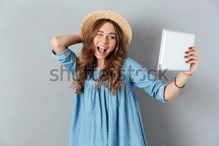 Picture of Pleased woman in sweater rejoices with closed eyes Stock photo © deandrobot