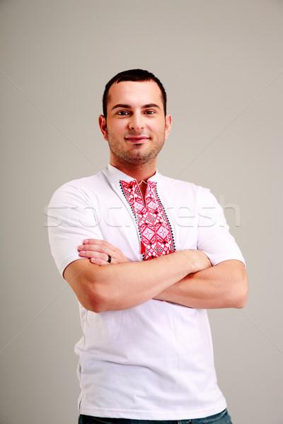 Portrait of happy man in the Ukrainian national clothes Stock photo © deandrobot
