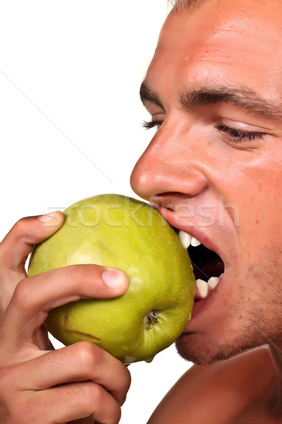 Young mad man Holding Green Apple Stock photo © deandrobot