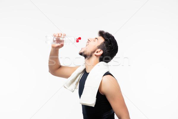 спортивных человека питьевая вода полотенце изолированный белый Сток-фото © deandrobot