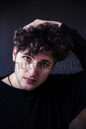Young handsome man looking at camera  Stock photo © deandrobot