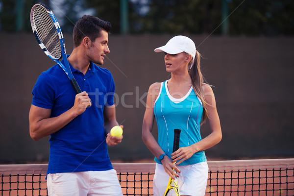 Pareja hablar pista de tenis retrato mujer Foto stock © deandrobot