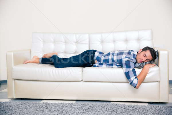 Man sleeping in cloth on the sofa at home Stock photo © deandrobot