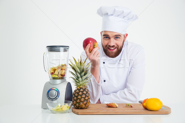 Stock photo: Portrait of a smiling male chef cook with fruits